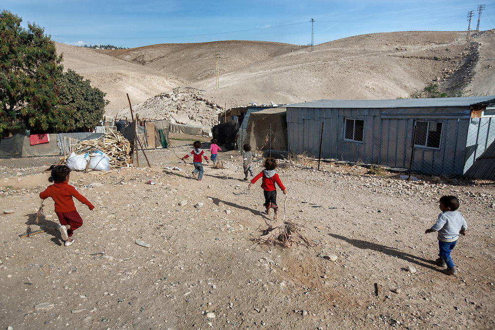 Children at play in Abu Dahuk. Nov. 27, 2013. West Bank, Palestinian Territories. (Photo by Gabriel Romero/Alexia Foundation ©2014)