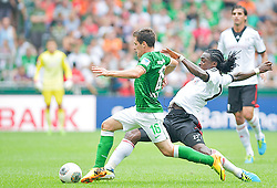 "28.07.2013, Weserstadion, Bremen, GER, 1.FBL, ""Tag der Fans 2013"" des SV Werder Bremen, Testspiel SV Werder Bremen vs Fulham FC, im Bild Zlatko Junuzovic (Bremen #16) am Ball, von hinten kommt Sascha Riether (Fulham FC #27) // during the ""Tag der Fans 2013"" of the German Bundesliga Club SV Werder Bremen at the Weserstadion, Bremen, Germany on 2013/07/28. EXPA Pictures © 2013, PhotoCredit EXPA Andreas Gumz ***** ATTENTION - OUT OF GER *****"