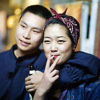 BEIJING, SEPT.30 : A trendy young couple  during a DJ party at School Bar, a  new trendy music venu in Beijing.