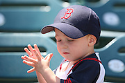 ANAHEIM, CA - MAY 14:  A young fan of the Boston Red Sox claps his hands before the game against the Los Angeles Angels of Anaheim at Angel Stadium in Anaheim, California on Thursday, May 14, 2009.  The Angels defeated the Red Sox 5-4 in 12 innings.  (Photo by Paul Spinelli/MLB Photos)