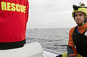 Greece, Chios<br /> A Basque humanitarian sea rescue  team (Salvamento maritimo humanitario SMH) accompanied with their speedboat a refugee boat to the greek coast.They intervene only when the refugee boat gets into distress. Otherwise they would provide aid to smuggling people. Nearby a Frontex policeboat is  observing all boats not allowing to get in contact and let them photographed together with Frontex boat.<br /> <br /> Keine Veroeffentlichung unter 50 Euro*** Bitte auf moegliche weitere Vermerke achten***Maximale Online-Nutzungsdauer: 12 Monate !!