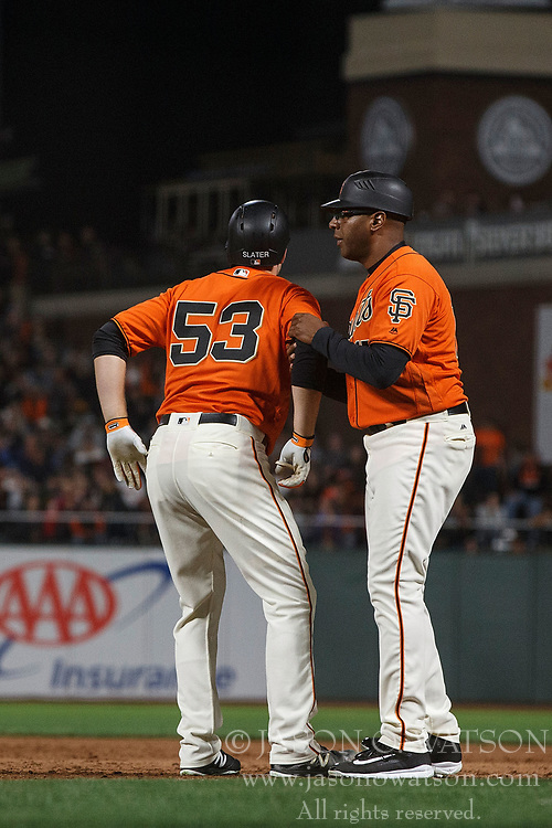 SAN FRANCISCO, CA - JULY 07: Austin Slater #53 of the San Francisco Giants is assisted by first base coach Jose Alguacil #17 after sustaining an injury during the eighth inning against the Miami Marlins at AT&T Park on July 7, 2017 in San Francisco, California. The Miami Marlins defeated the San Francisco Giants 6-1. (Photo by Jason O. Watson/Getty Images) *** Local Caption *** Austin Slater; Jose Alguacil