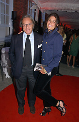DIEGO DELLA VALLE and ELIZABETH SALTZMAN at a party to celebrate the opening of Roger Vivier in London held at The Orangery, Kensington Palace, London on 10th May 2006.<br />
