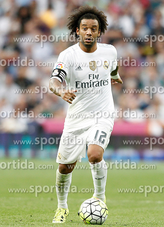 26.09.2015, Estadio Santiago Bernabeu, Madrid, ESP, Primera Division, Real Madrid vs Malaga CF, 6. Runde, im Bild Real Madrid's Marcelo Vieira // during the Spanish Primera Division 6th round match between Real Madrid and Malaga CF at the Estadio Santiago Bernabeu in Madrid, Spain on 2015/09/26. EXPA Pictures &copy; 2015, PhotoCredit: EXPA/ Alterphotos/ Acero<br /> <br /> *****ATTENTION - OUT of ESP, SUI*****