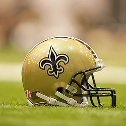 12 August 2009: A Saints helmet on the field during New Orleans Saints training camp at the team's indoor practice facility in Metairie, Louisiana.
