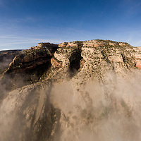 USA, Colorado, Grand Junction, Aerial view of winter fog above mesas along eastern side of Colorado National Monument