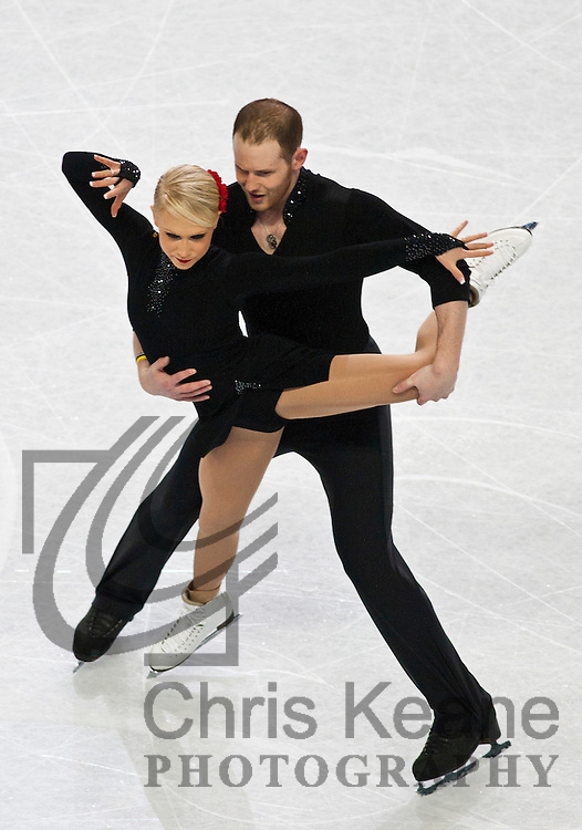 27 January 2011: John Coughlin and Caitlin Yankowskas skate during the pairs short program at the 2011 U.S. Figure Skating Championships at Greensboro Coliseum in Greensboro, North Carolina on January 27, 2011. FOR EDITORIAL USE ONLY. Chris Keane Photography reserves the right to pursue unauthorized users of this image. If you violate our intellectual property you may be liable for: actual damages, loss of income, and profits you derive from the use of this image, and, where appropriate, the costs of collection and/or statutory damages up to $150,000 (USD).
