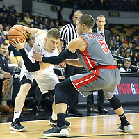 ORLANDO, FL - NOVEMBER 15: Liam O'Reilly #5 of the Gardner Webb Runnin Bulldogs defends against Nathan Laing #51 of the UCF Knights during a NCAA basketball game at the CFE Arena on November 15, 2017 in Orlando, Florida. (Photo by Alex Menendez/Getty Images) *** Local Caption *** Liam O'Reilly; Nathan Laing