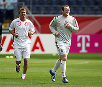 Photo: Chris Ratcliffe.<br /> England training session. FIFA World Cup 2006. 09/06/2006.<br /> David Beckham and Wayne Rooney in training before the game tomorrow.