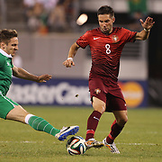 João Moutinho, Portugal, is challenged by Kevin Doyle, Ireland, during the Portugal V Ireland International Friendly match in preparation for the 2014 FIFA World Cup in Brazil. MetLife Stadium, Rutherford, New Jersey, USA. 10th June 2014. Photo Tim Clayton