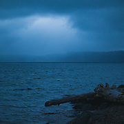 Light breaking through storm clouds over Vashon Island - taken from Browns Point, WA