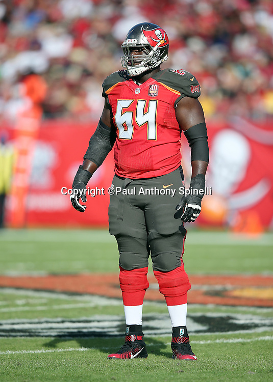 Tampa Bay Buccaneers offensive guard Kevin Pamphile (64) looks on during the 2015 week 14 regular season NFL football game against the New Orleans Saints on Sunday, Dec. 13, 2015 in Tampa, Fla. The Saints won the game 24-17. (©Paul Anthony Spinelli)