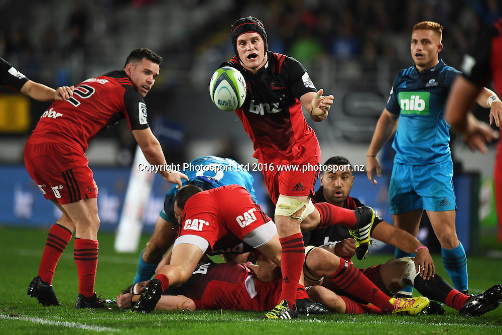 Matt Todd gets his pass away during the Blues v Crusaders Super Rugby match at Eden Park, Auckland, New Zealand. Saturday 28 May 2016. © Copyright Photo: Andrew Cornaga / www.Photosport.nz