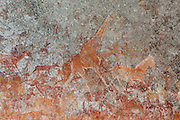 Giraffe and other wildlife depicted in San bushman rock paintings, estimated at around 2000 years old, in Nswatugi Cave in Matobo National Park, Zimbabwe.