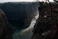 Late afternoon sunlight streams through the canyons that make Victoria Falls, as the water from the main falls mixes with that from the other cataracts in what is known as the boiling point.