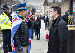 © Licensed to London News Pictures. 13/03/2019. London, UK. Pro-Brexit Conservative MP Steve Baker (R) talks with Stop-Brexit campaigner Steve Bray outside Parliament ahead of tonight's vote to rule out a no deal on exiting the European Union. Photo credit: Peter Macdiarmid/LNP