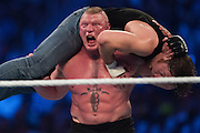 Brock Lesnar slams Dean Ambrose during WrestleMania on April 3, 2016 in Arlington, Texas.