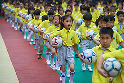 June 20, 2017 - Children perform with footballs during a football festival at the Central Kindergarten in Changxing County, east China's Zhejiang Province. (Credit Image: © Xu Yu/Xinhua via ZUMA Wire)