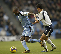 Photo: Aidan Ellis.<br /> Manchester City v Tottenham Hotspur. The Barclays Premiership. 17/12/2006.<br /> City's Hatem Trabelsi holds off Spurs Lee Young Pyo