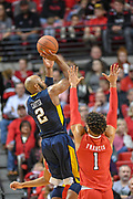 LUBBOCK, TX - JANUARY 13: Jevon Carter #2 of the West Virginia Mountaineers shoots the ball over Brandone Francis #1 of the Texas Tech Red Raiders during the game on January 13, 2018 at United Supermarket Arena in Lubbock, Texas. Texas Tech defeated West Virginia 72-71. (Photo by John Weast/Getty Images) *** Local Caption *** Jevon Carter;Brandone Francis
