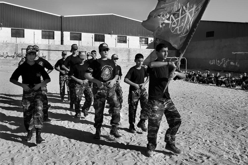 Young Palestinian boys learn to march in formation under the HAMAS flag during an August 05, 2007 HAMAS sponsored summer camp in the Nuseirat camp in the Gaza strip. Kids at the camp are given military style training   6 days a week at the camp for 3 hours per day.