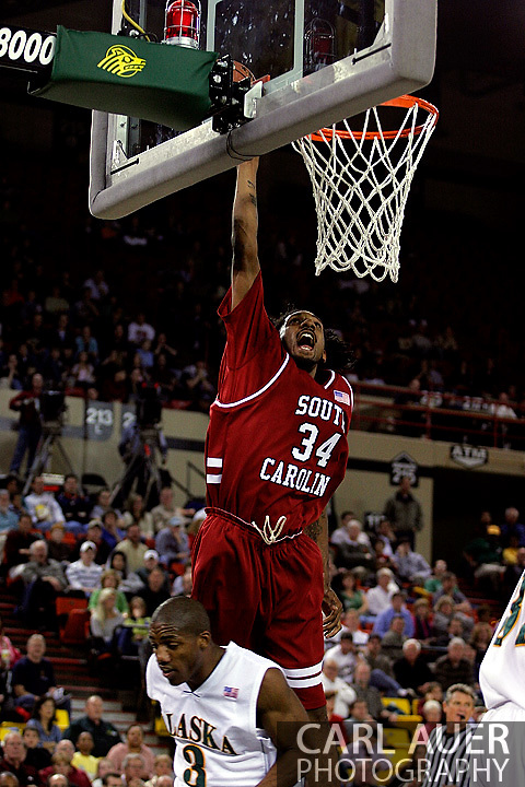 24 November 2005:Junior forward Renaldo Balkman (34) from the University of South Carolina scores an easy two in the Gamecock's 65 - 60 victory over the University of Alaska Anchorage Seawolves in the first round of the Great Alaska Shootout at the Sullivan Arena in Anchorage Alaska.