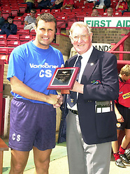 KETTERING MANAGER CARL SHUTT RECIEVES HIS DR MARTINS MANAGER OF THE (MONTH/YEAR) FROM DOUG GILLARD DR MARTINS CHAIRMAN 27/7/02 Kettering Town v Dorchester Hillier Cup Rockingham Road, July 2002