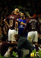 Photo: Daniel Hambury.<br />Arsenal v Manchester United. The Barclays Premiership.<br />03/01/2006.<br />Arsenal's Cesc Fabregas (R) and Pascal Cygan (L) surround  United's Ryan Giggs (centre) after his challange on Jose Antonio Reyes(seated).