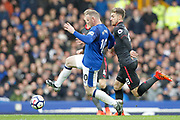 Everton striker Wayne Rooney (10) and Arsenal midfielder Aaron Ramsey (8) during the Premier League match between Everton and Arsenal at Goodison Park, Liverpool, England on 22 October 2017. Photo by Craig Galloway.