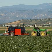 Tractor applying fertilizer. Oxnard, CA. USA