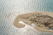 Sand bar in shape of Sri Lanka. Possibly Kalpitiya lagoon.