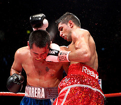 Amir Khan lands a left during the WBA and WBO Inter-Continental Lightweight title fight between Amir Khan and Marc Antonio Barrera at the MEN Arena on March 14, 2009 in Manchester, England.