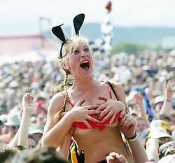 Fan wearing a bikini at the main stage on Sunday 10th July 2005 at T in the Park, Balado, Scotland..PIC : ©Michael Schofield.