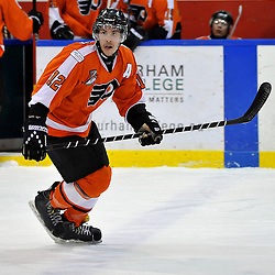WHITBY, ON - Feb 11: Ontario Junior Hockey League game between Orangeville Flyers and Whitby Fury. Peter Stepanis #12 of the Orangeville Flyers Hockey Club during third period game action.<br /> (Photo by Shawn Muir / OJHL Images)