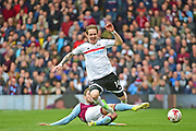 Fulham midfielder Stefan Johansen (14) is tackled during the EFL Sky Bet Championship match between Fulham and Aston Villa at Craven Cottage, London, England on 17 April 2017. Photo by Jon Bromley.