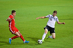WREXHAM, WALES - Tuesday, September 10, 2019: Wales' Cameron Coxe (L) and Germany's Luca Kilian during the UEFA Under-21 Championship Italy 2019 Qualifying Group 9 match between Wales and Germany at the Racecourse Ground. (Pic by David Rawcliffe/Propaganda)