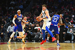 December 21, 2018 - Los Angeles, CA, U.S. - LOS ANGELES, CA - DECEMBER 20: Dallas Mavericks Guard Luka Doncic (77) steals the ball from Los Angeles Clippers Guard Lou Williams (23) during a NBA game between the Dallas Mavericks and the Los Angeles Clippers on December 20, 2018 at STAPLES Center in Los Angeles, CA. (Photo by Brian Rothmuller/Icon Sportswire) (Credit Image: © Brian Rothmuller/Icon SMI via ZUMA Press)