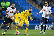 Bolton Wanderers midfielder Liam Trotter carries the ball under pressure from  Mirco Antenucci of Leeds United  during the The FA Cup fourth round match between Bolton Wanderers and Leeds United at the Macron Stadium, Bolton, England on 30 January 2016. Photo by Simon Brady.