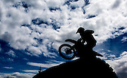 A dirt bike flies over a new obstacle during a race at Mosquito Road.