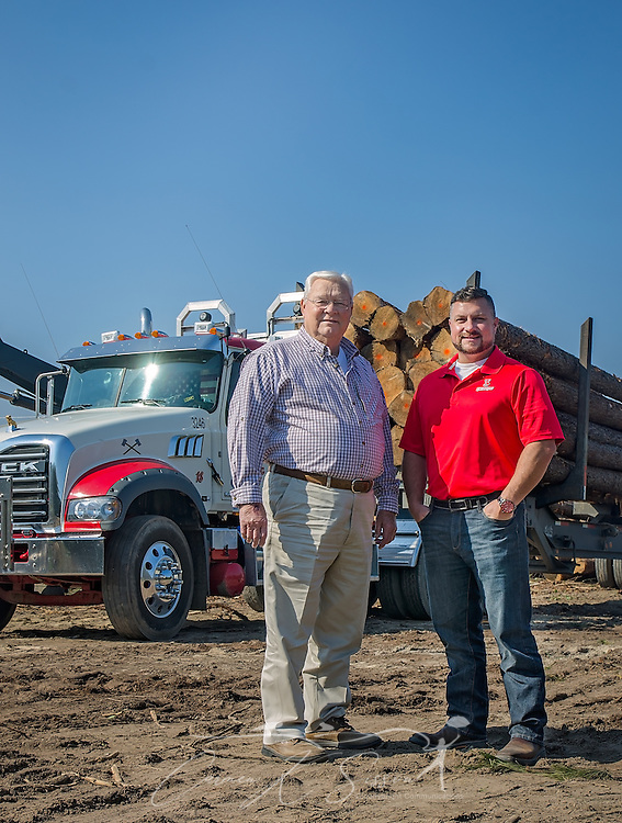 Tracy Gunter Jr. and his son, Tracy Gunter III, stand on a job site with one of the Mack Granites they use in their logging business, Nov. 16, 2016, in Steadham, S.C. The men own and operate Tracy's Logging and T3 Chipping, where they oversee four logging crews and two chipping crews, averaging 300 loads per week. (Photo by Carmen K. Sisson)
