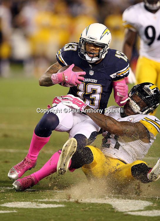 San Diego Chargers wide receiver Keenan Allen (13) gets tackled by Pittsburgh Steelers safety Robert Golden (21) after catching a late second quarter pass for a first down during the 2015 NFL week 5 regular season football game against the Pittsburgh Steelers on Monday, Oct. 12, 2015 in San Diego. The Steelers won the game 24-20. (©Paul Anthony Spinelli)
