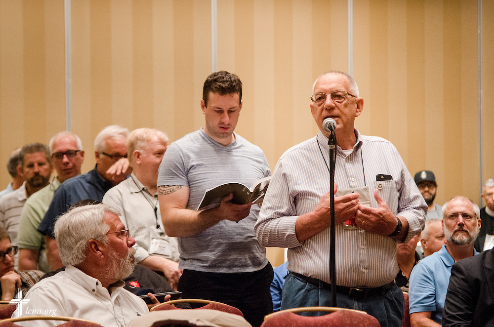 "A voting delegate speaks during an open hearing of Floor Committee #13 ""Routes to Ministry"" at the 66th Regular Convention of The Lutheran Church–Missouri Synod on Saturday, July 9, 2016, in Milwaukee. LCMS/Frank Kohn"