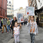 Animal rights activists hold banner protest dolphin killings outside Japanese Embassy. Every year thousands of dolphins are slaughtered in a small cove in the town of Taiji, Japan on 31 August 2018, London, UK.