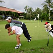 HONOLULU, HAWAII, November 8, 2007: Tadd Fujikawa, a sixteen-year-old professional golfer, goofs off with his mother, Lori, at the Honolulu Country Club in Honolulu, Hawaii. (Photographs by Todd Bigelow/Aurora)