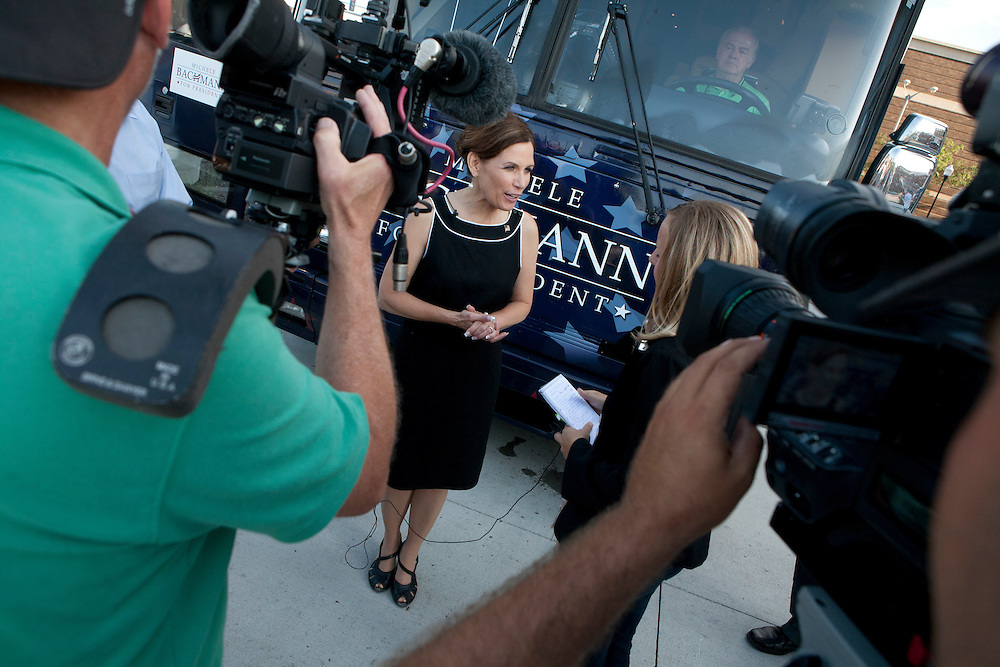 Republican presidential hopeful Michele Bachmann talks to reporters after a campaign stop on Sunday, July 24, 2011 in Davenport, IA.