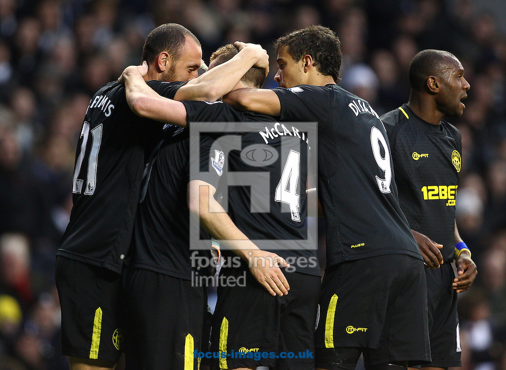 Picture by Paul Terry/Focus Images Ltd +44 7545 642257.03/11/2012.Ben Watson of Wigan Athletic celebrates with team mates after scoring to make it 1-0 during the Barclays Premier League match at White Hart Lane, London.