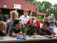 Natalie Cullen, Noah Cullen and Keagan Huse watch Kyle Saucier try for the biggest bubble during the bubblegum blowing contest at the 4H Fair Saturday afternoon at the Belmont Fairgrounds.  (Karen Bobotas/for the Laconia Daily Sun)