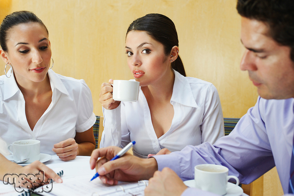 Three business colleagues in office meeting