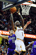 Oct. 30, 2010; Cleveland, OH, USA; Cleveland Cavaliers point guard Daniel Gibson (1) drives past Sacramento Kings point guard Beno Udrih (19) during the first quarter at Quicken Loans Arena. Mandatory Credit: Jason Miller-US PRESSWIRE