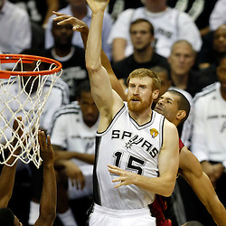 Jun 11, 2013; San Antonio, TX, USA; San Antonio Spurs power forward Matt Bonner (15) shoots as he is defended by Miami Heat small forward Shane Battier (31) in the second quarter during game three of the 2013 NBA Finals at the AT&T Center. Mandatory Credit: Derick E. Hingle-USA TODAY Sports